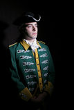 Soldier in historical uniform. Portrait of young male soldier in historical uniform, isolated on black background Royalty Free Stock Photos