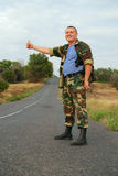 Soldier hitchhiker Stock Photography
