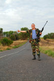 Soldier hitchhiker Stock Images
