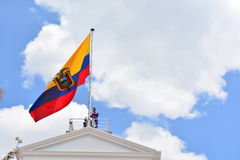 Soldier Hoisting the flag of Ecuador in Quito. Presidential soldier hoisting the flag of Ecuador over the Carondelet palace, in Quito stock photo