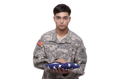 Soldier with holding an American flag Royalty Free Stock Photography