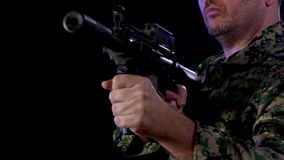 Soldier holding assault rifle. Soldier in army fatigues holding assault rifle stock video