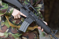 Soldier holding automatic rifle Royalty Free Stock Photos