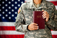 Soldier: Holding a Bible. Series with a female as a solidier in an United States Army uniform.  Numerous props convey a variety of concepts Stock Image