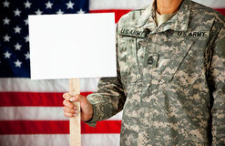 Soldier: Holding a Blank Sign. Series with a female as a solidier in an United States Army uniform.  Numerous props convey a variety of concepts Royalty Free Stock Images