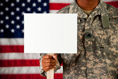 Soldier: Holding Blank Sign on Stick Stock Images