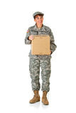 Soldier: Holding a Cardboard Box. Series with a female as a solidier in an United States Army uniform.  Numerous props convey a variety of concepts.  Isolated on Stock Images