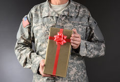 Soldier Holding Christmas Present Royalty Free Stock Images
