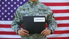 Soldier holding confidential folder in hands, secret agency information security. Stock footage stock footage