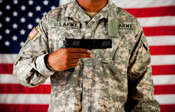 Soldier: Holding a Gun in Front Stock Image