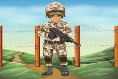 A soldier holding a gun Royalty Free Stock Image