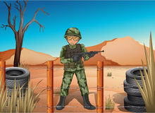 A soldier holding a gun Stock Image