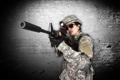 Soldier holding his assault rifle Royalty Free Stock Images