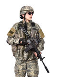 Soldier holding his assault rifle Stock Images