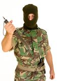 Soldier holding a knife. Soldier with a military mask holding a knife Royalty Free Stock Image