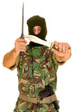 Soldier holding a knife. Soldier with a military mask holding a knife Royalty Free Stock Photo