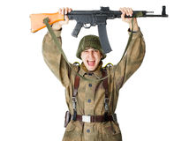 Soldier holding machine gun over head Royalty Free Stock Photo