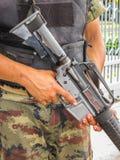 Soldier holding a machine gun. Stock Photos