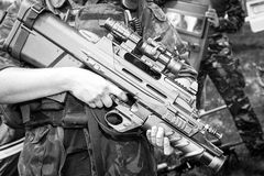 Soldier holding a machine gun in standing position Stock Images