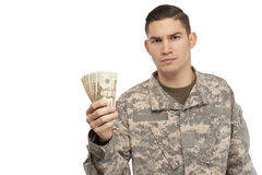 Soldier holding money Royalty Free Stock Images