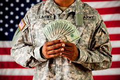 Soldier: Holding Money Fan. Series with an anonymous African-American soldier on a United States Flag background royalty free stock image