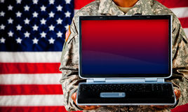 Soldier: Holding Monitor with Blank Screen Stock Photo