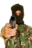 Soldier holding a pistol. Soldier with a military mask holding a pistol and focus on the pistol Royalty Free Stock Photos