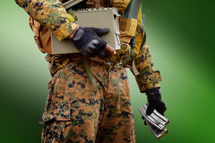 Soldier Holding the rifle 5.56mm loader on grren background Royalty Free Stock Photos
