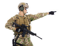 Soldier holding rifle or sniper and directing Stock Photos