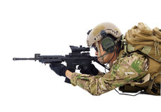 Soldier holding rifle or sniper lying on the floor Stock Image