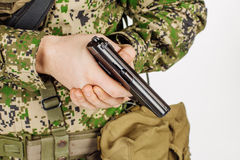 Soldier holding a russian 9mm handgun PM Makarov. Training of Stock Images