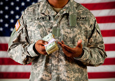 Soldier: Holding Stack of Money Stock Image