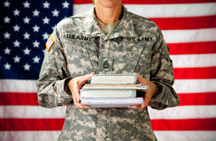 Soldier: Holding Stack of Text Books Stock Photos