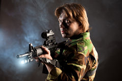 Soldier holding a weapon Royalty Free Stock Image