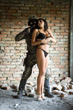 Soldier holding woman Royalty Free Stock Photos