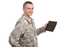 Serviceman holding a computer tablet. A soldier holds his tablet Stock Photo