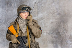 Soldier holds a radio station Stock Photography