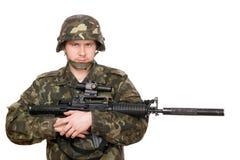 Soldier hugging m16 Stock Photos