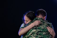 Soldier hugs daughter on departing or returning royalty free stock photo