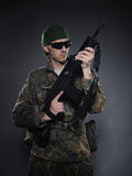 Soldier In Camouflage And Ammunition With A Rifle Stock Photos