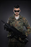 Soldier In Camouflage And Ammunition With A Rifle Stock Images