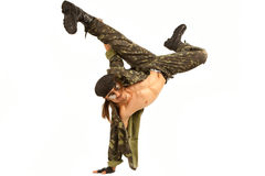 Soldier jumping. Like break dancer isolated on white background royalty free stock photography