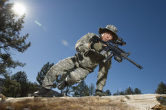Soldier Jumping Over Log Royalty Free Stock Images