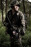 Soldier in the jungle. Soldier on mission in the jungle stock photo