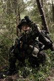 Soldier in the jungle stock images