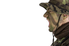 Soldier with jungle camouflage paint shouting out orders. Isolated on white background royalty free stock photos