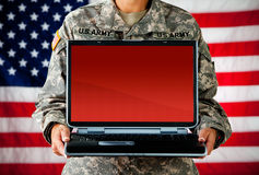 Soldier: Laptop with Blank Screen. Series with a female as a solidier in an United States Army uniform.  Numerous props convey a variety of concepts Stock Photos