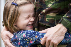 Soldier On Leave Being Hugged By Daughter Royalty Free Stock Image