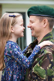 Soldier On Leave Hugging Daughter stock image