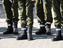 Soldier legs with boots Stock Images
